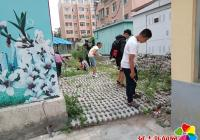 民旺社区组织青少年志愿者清理社区环境
