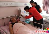 春阳社区上门为住院老人进行生存认证 争做居民暖心人