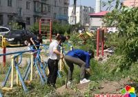 """园校社区开展""""创建文明城 你我共参与""""集中整治活动"""