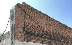 长新社区协调烟厂加固危墙