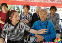 延春社区流动民主协商议事会开到居民区