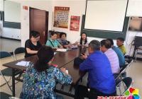 白梅社区支部党员认领小区种花 扮靓城市环境