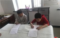 白菊社区教娃娃书法传承书法精粹