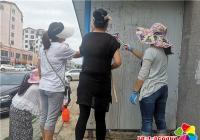 居民参与创城活动 小区环境焕然一新