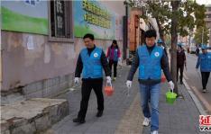 白桦社区携手州供销社开展志愿服务活动改善小区环境