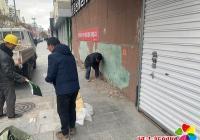 新兴街道民安社区依托路长制工作,修补脱落墙皮