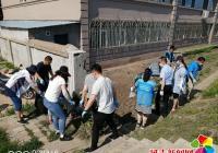 """园新社区开展""""美化居住环境  助力创城""""志愿服务活动"""