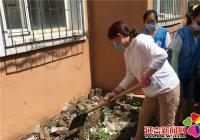 河南街道携手市档案馆、烟厂社区清理乱堆乱放 营造整洁家园