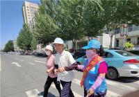 交通劝导志愿服务让文明之风吹遍每条街路