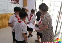 """园校社区开展""""创建文明城,我参与我快乐""""小小志愿服务活动"""