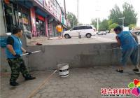 丹虹社区粉刷外墙助力创城新成效