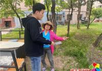 """丹明社区开展""""拒绝圈地种菜 保护绿色家园""""活动"""
